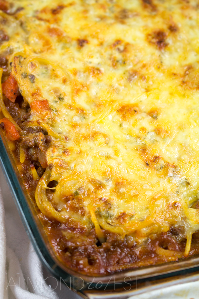 Spaghetti Bolognaise Bake - This spag bol bake will become a family favorite loaded with flavor, a creamy texture and a crispy golden cheese layer! YUM!!